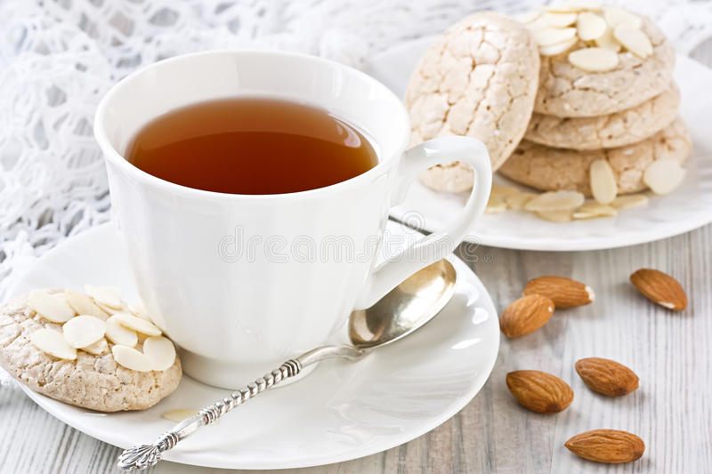 white-cup-tea-almond-cookies-porcelain-almonds-slices-38732272.jpg