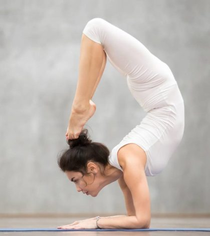 9-Yoga-Asanas-You-Should-Know-–-Beginner-Intermediate-And-Advanced-2-624x702
