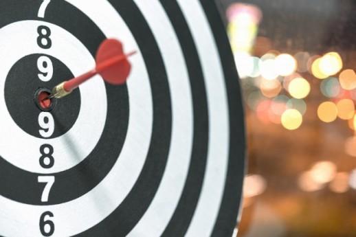 dart-target-arrow-hitting-bullseye-with-bokeh-background_1357-303