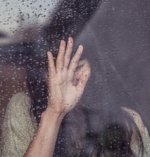woman_rain_window